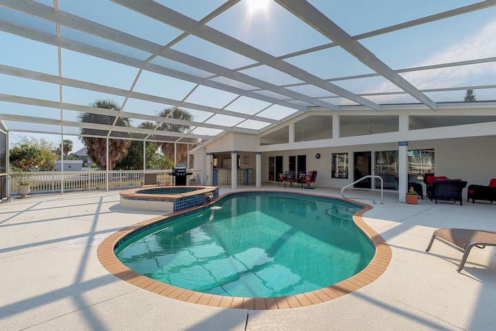 Waterfront and dog-friendly home with private pool, dock, views, and lanai!