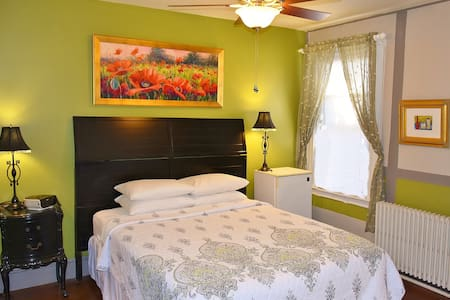 Room 6-Second Floor/Private Bathroom/ Queen Bed-maximum occupancy 2/Air-Conditioned/Flat Screen Television/Ceiling Fan/Refrigerator/WiFi