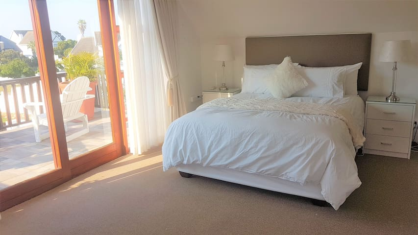 Main bedroom with en suite bathroom leading onto a beautiful tiled  balcony overlooking the canals