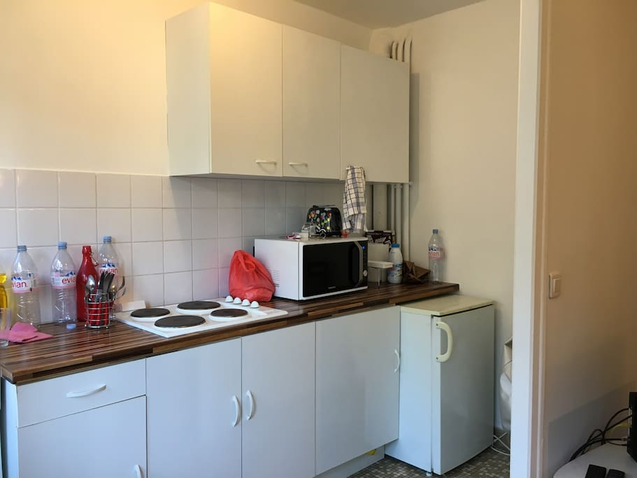 Kitchen with microwave, mini-fridge and toaster.