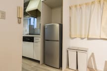 Kitchen with full sized fridge and gas stove