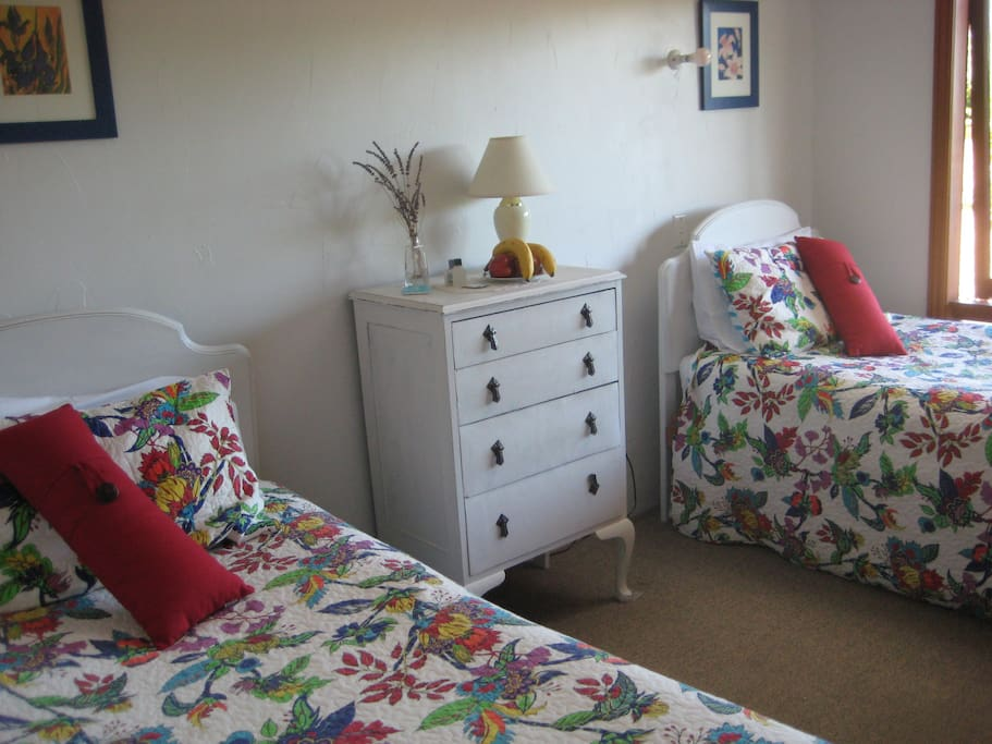 The twin room with shared bathroom