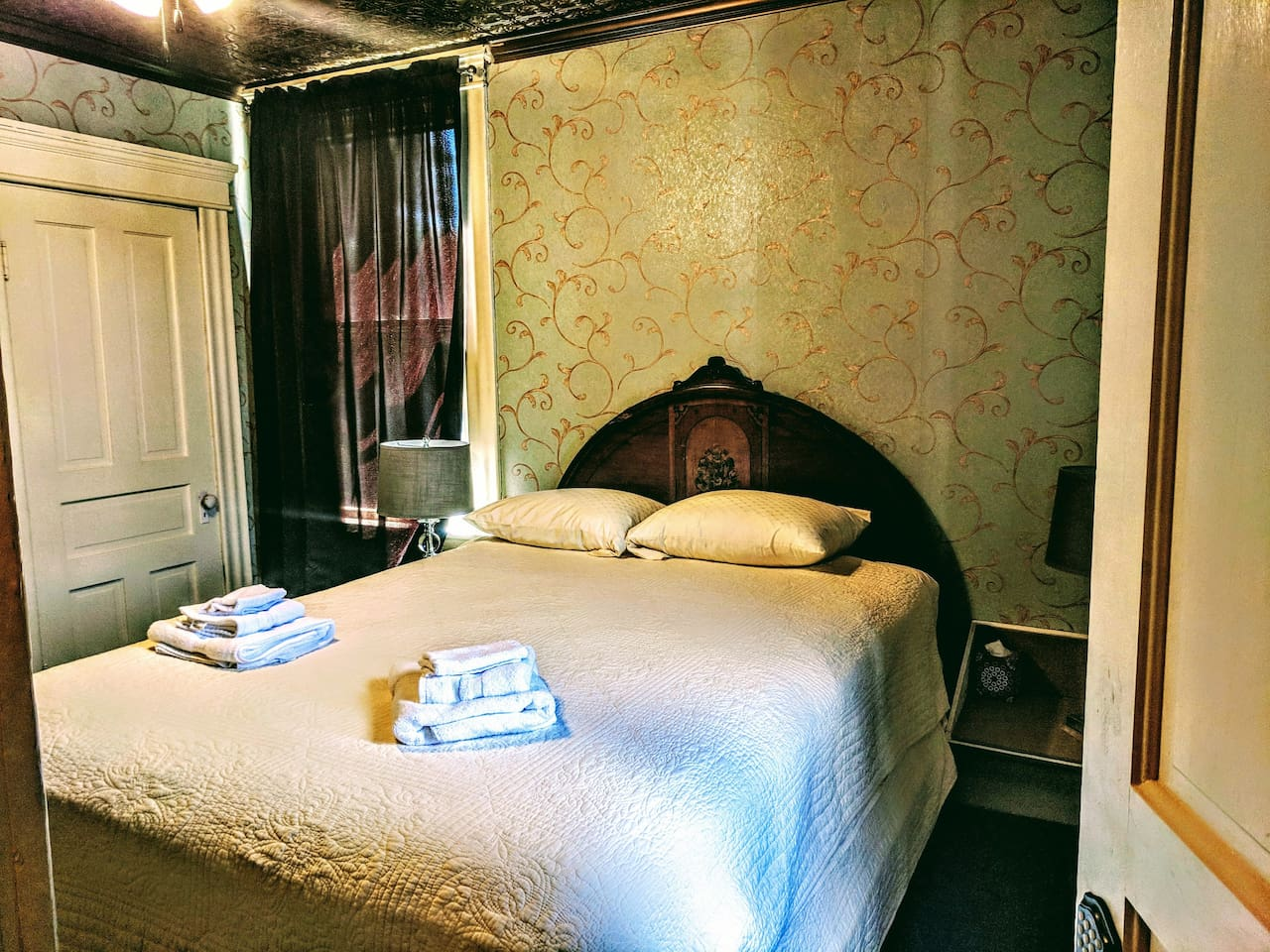 Two room suite with a queen bed in one room and a twin day bed with twin trundle in the adjoining bedroom. TV in each room