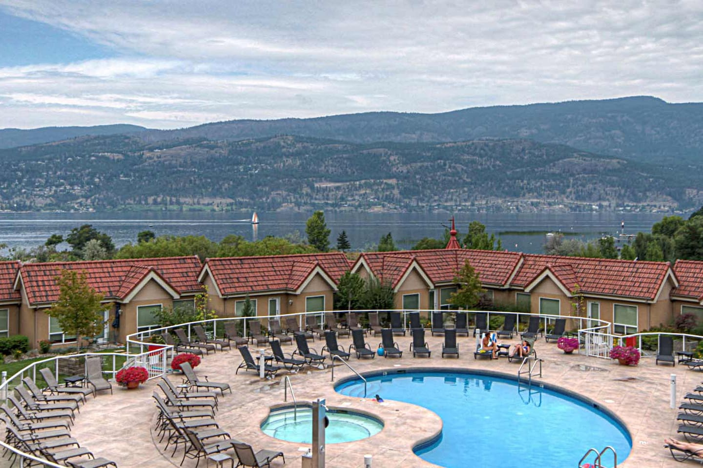 Outdoor pool and lake view from deck