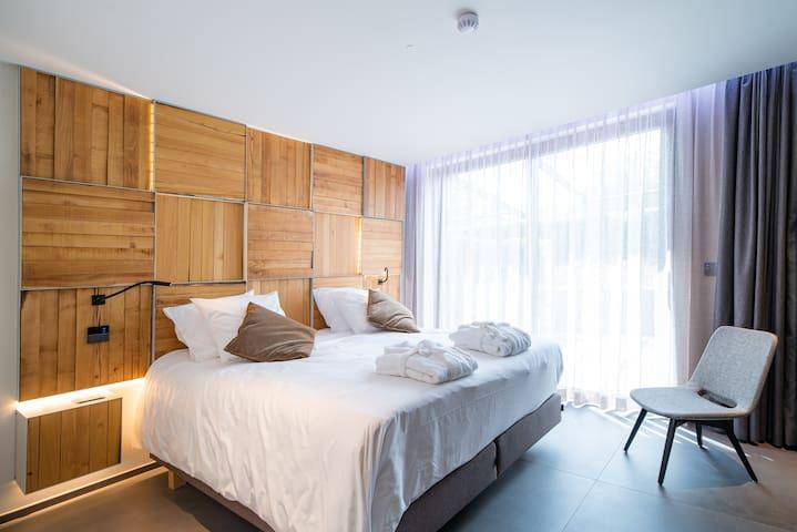 """Chambre confort """"été"""" (terrasse et accès wellness)"""