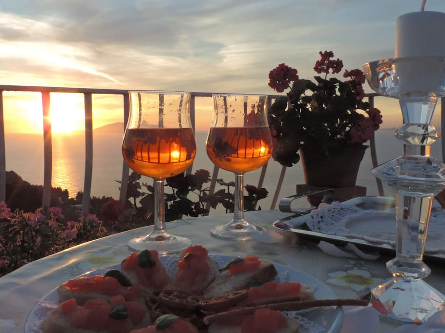 You can enjoy a free aperitif admiring the amazing sunset from our outside areas