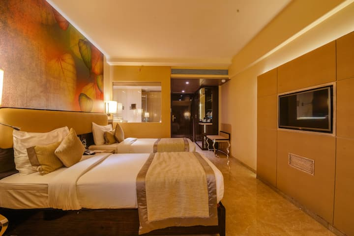 Deluxe room in a hotel at Malad West