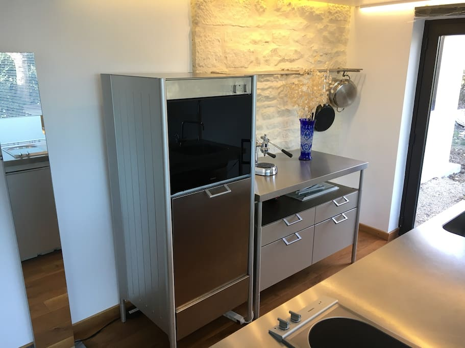 Gaggenau oven and full sized dishwasher. Side door from kitchen area leads also into garden.