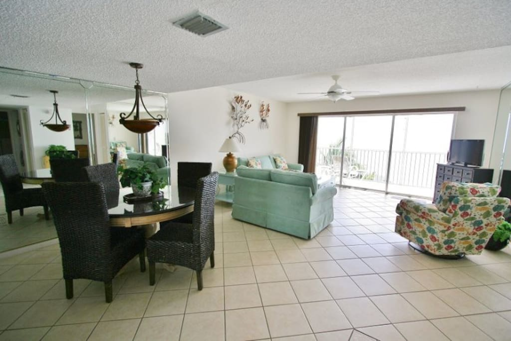 Seaside Villa Features a Spacious Living Area that Opens Up to Your Private Screened Balcony  Florida Keys Vacation Rental