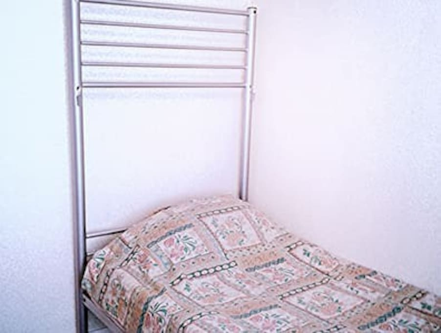 A cosy room with a single bed that comfortably fits one person.