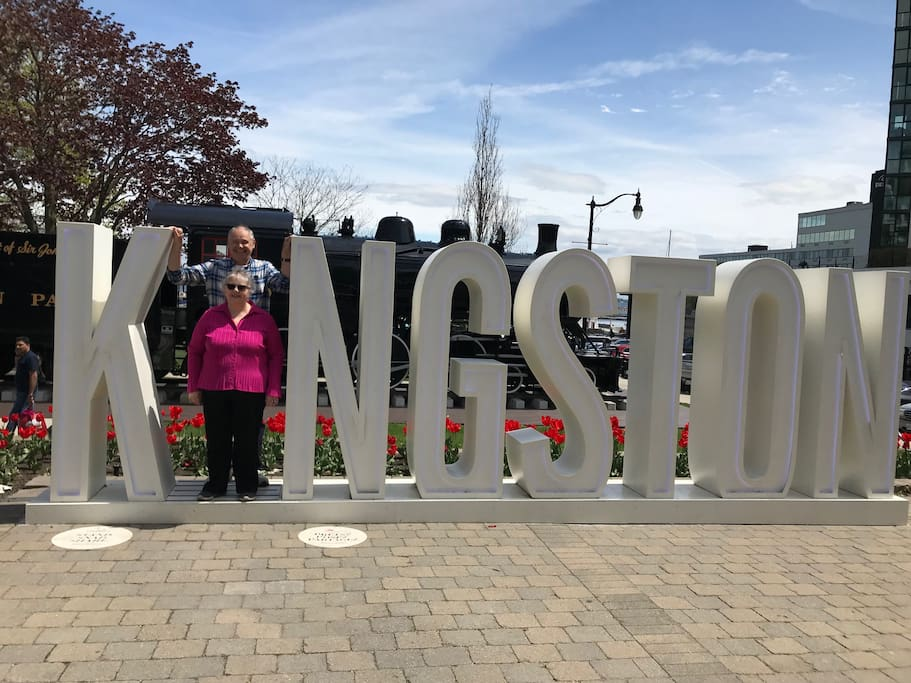 Heather and John at the Kingston sign