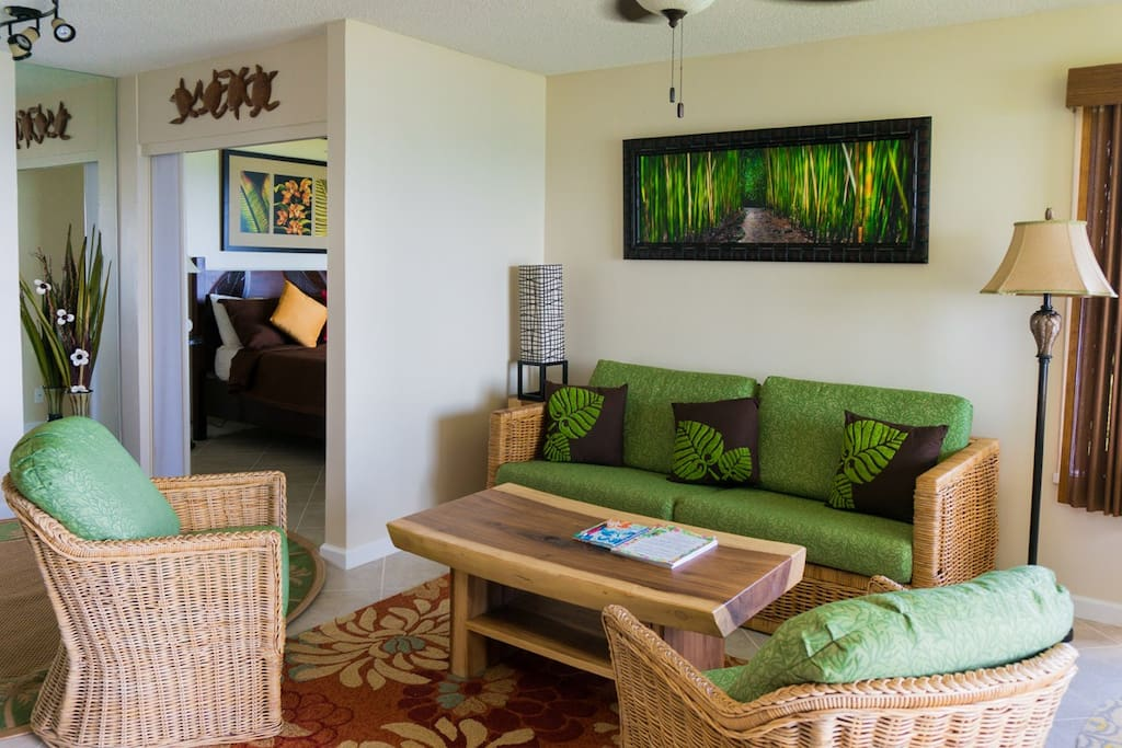 Cool, comfortable living room in our oceanfront Kauai vacation rental Sealodge G4