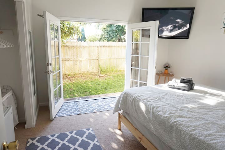 Large french doors open for perfect breeze