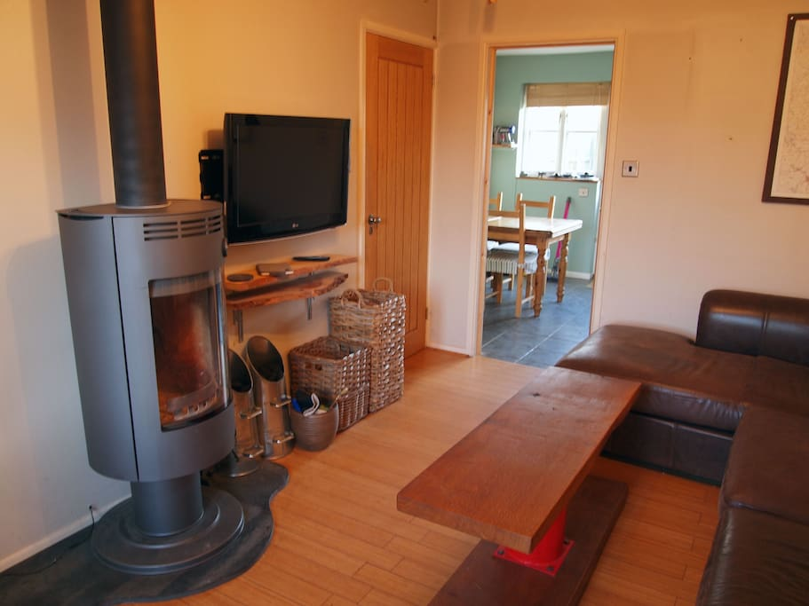 Shared living room with wood burning stove