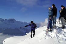 On snow shoes with a guide