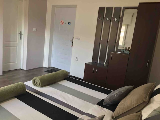 New comfortable beds, AC. Free wi-fi, cable TV, free snacks and bottled water, coffee & tea, kettle, private bathroom, free toiletries, towels, blow dryer, slippers, first aid kit, sowing kit, shoe cleaning kit, closet / wardrobe, table & chair set.