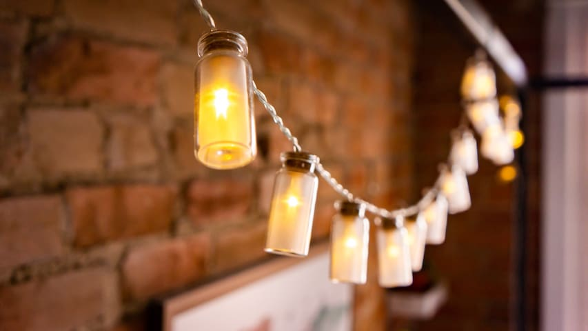 LED fairy lights reside in corked and stringed bottles overhead to aid in magical dreaming.
