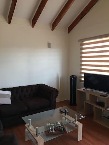 Acogedora sala con TV