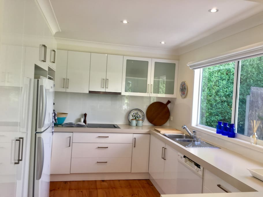 Modern kitchen with dishwasher, electric oven & hot plates