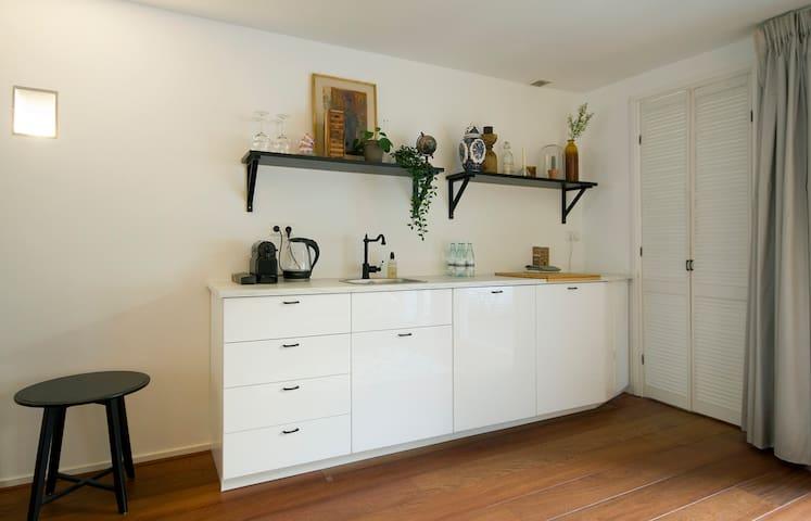 renovated kitchen with dishwasher and fridge