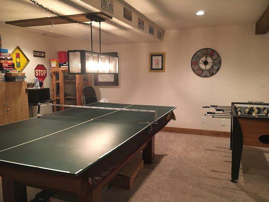 Ping pong/pool table with fooseball.