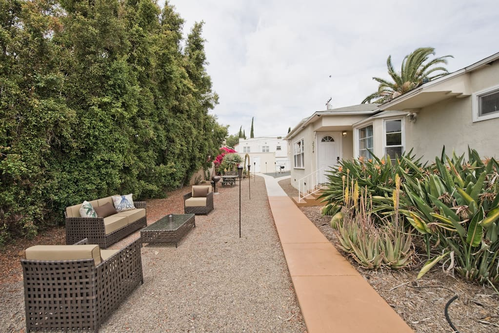 Huge private outdoor area - 3 seating areas for relaxing - bbq - fire- pit, tiki torches for nightime vibe - see later pictures for more