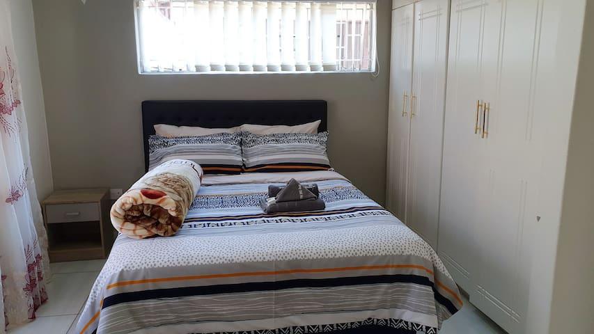 2nd En-suite bedroom with queen bed.
