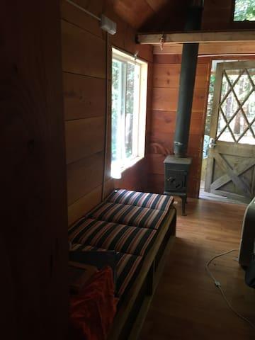 Tiny house w/ loft 4 sleeping on shared property.