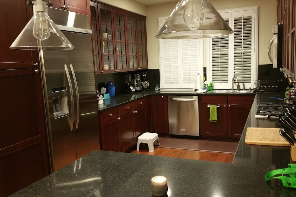 High-end stainless steel appliances, granite counters