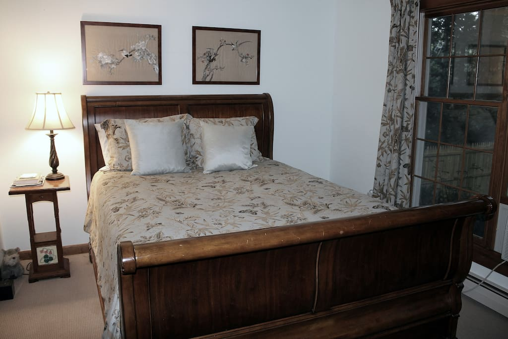 This is your bedroom, with queen size sleigh bed