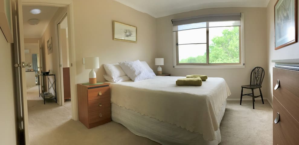Large, main bedroom with queen size bed and walk-in wardrobe. All linen is provided.