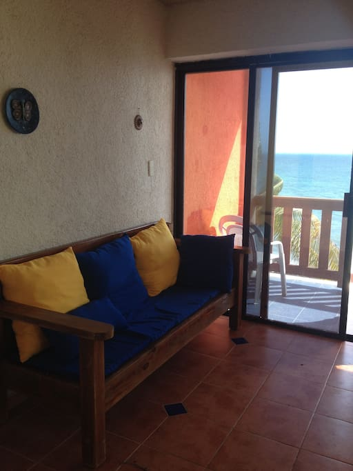 classic mexican furniture with new comfy pillows and amazing view of the sea
