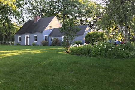 Well maintained home fenced in yard