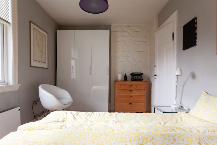 Second bedroom with a queen-size bed.