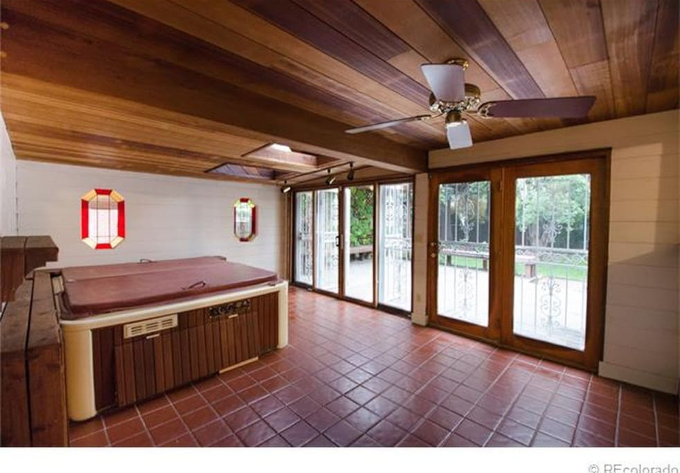 Patio, sunroom, deck, lots of room for barbecues, get togethers.