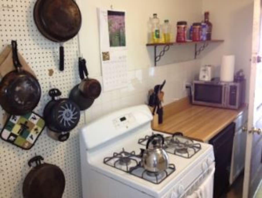 Stocked kitchen with gas stove.
