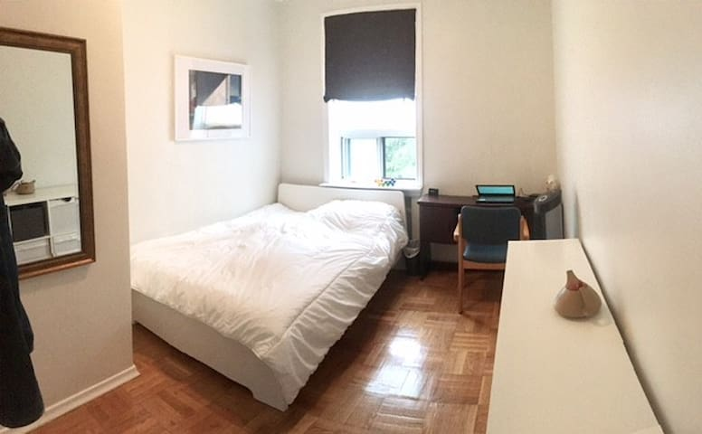Furnished, clean bedroom, in a spacious apartment.