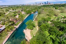 Barton Springs pool with downtown in the background
