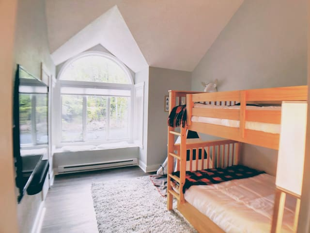 Bunk room with cozy bay window seat