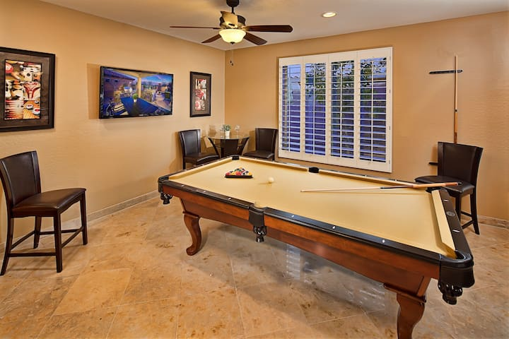Fun game room with TV and pool table.