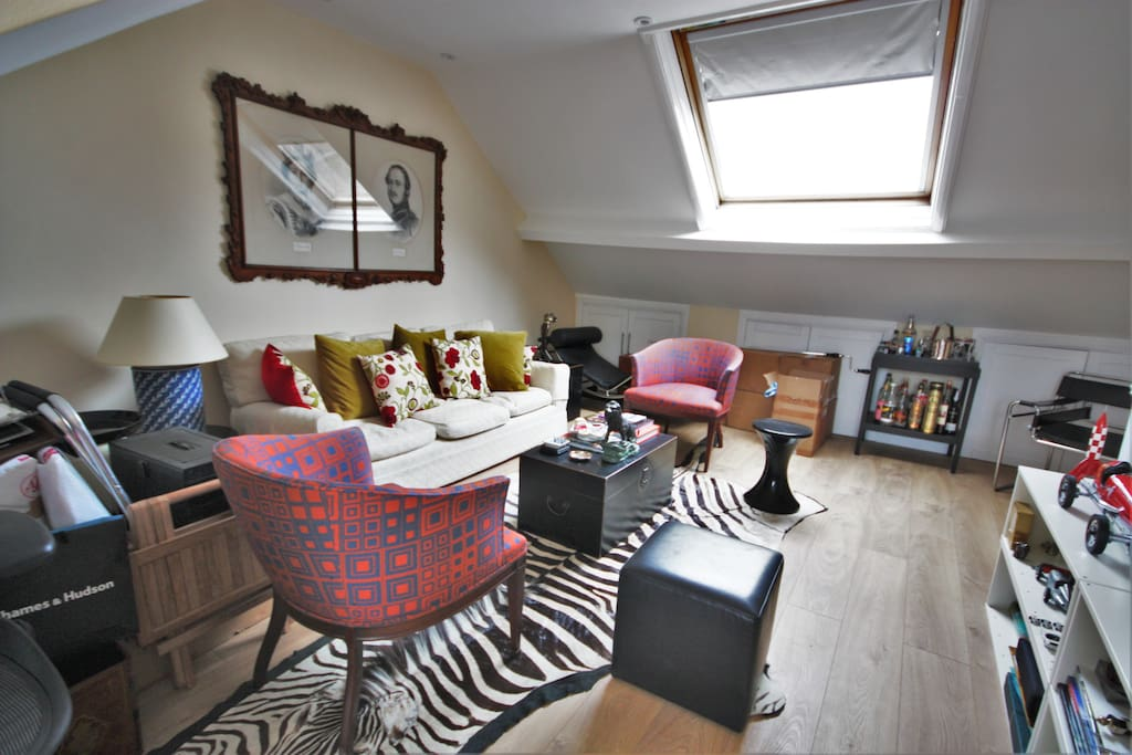 Charming loft sitting room with Velux window and access to terrace