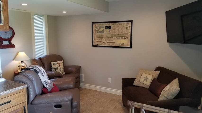Living Room with 2 Recliners, Sofa and Large HD TV