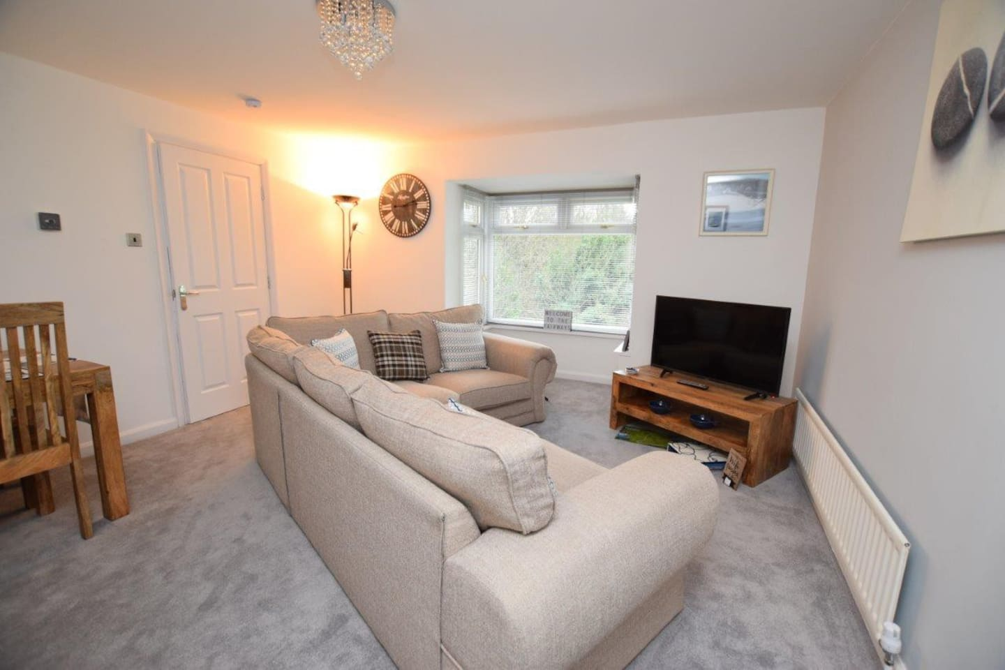 Lounge and dining area with views across communal garden and Roseberry Grange Golf Course