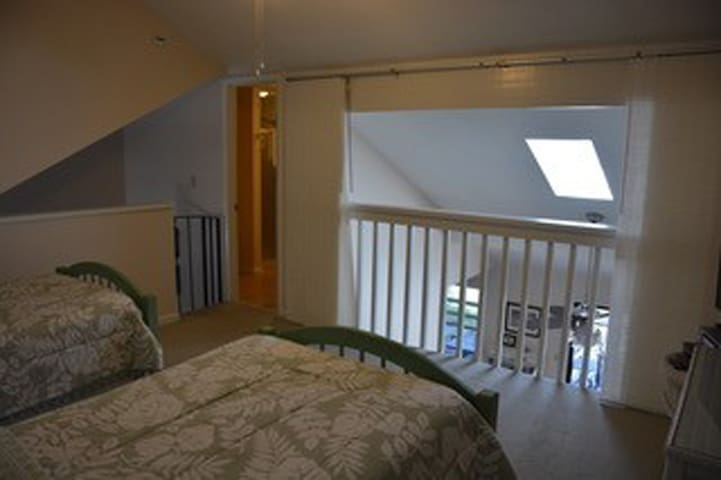 Loft bedroom with privacy curtains open