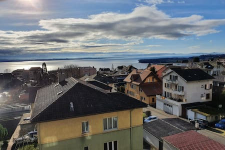 Appartement neuf sous combles, vue sur le lac