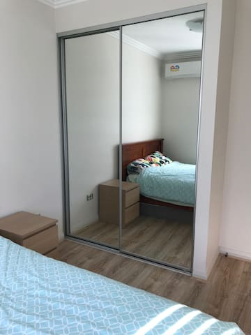Built in robe and queen size bed. Aircond and heating provided. New floor boards.