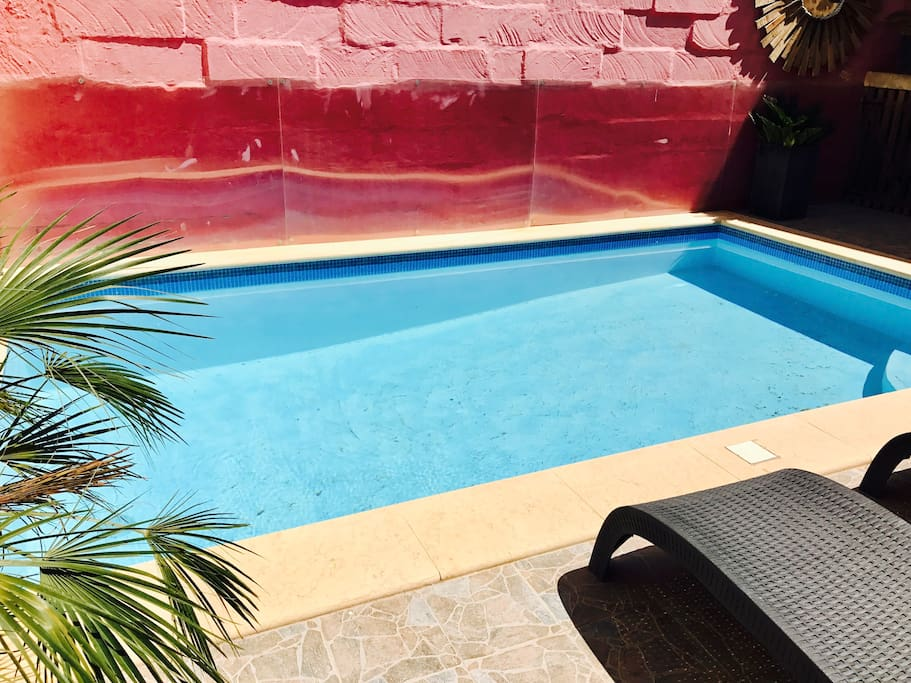 sunny private pool with sun loungers, gas BBQ and table + chairs