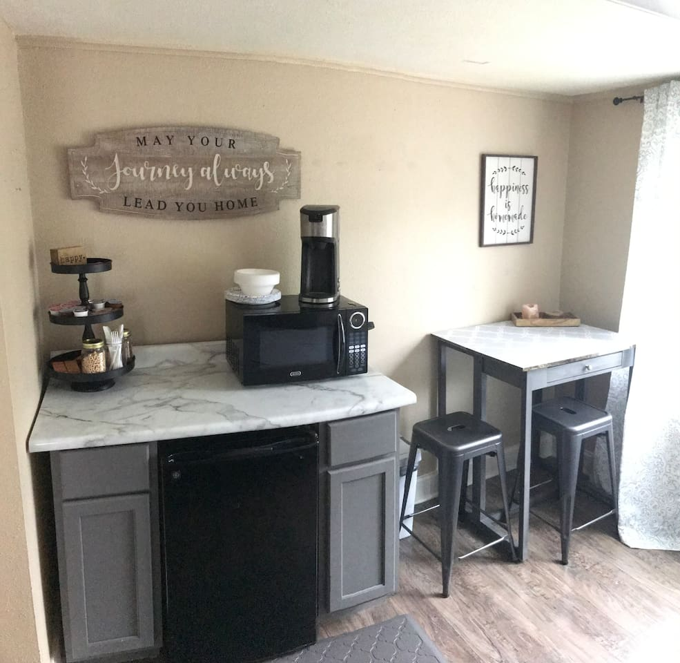 Kitchenette area with water bottles, soda, cereal, snacks and coffee