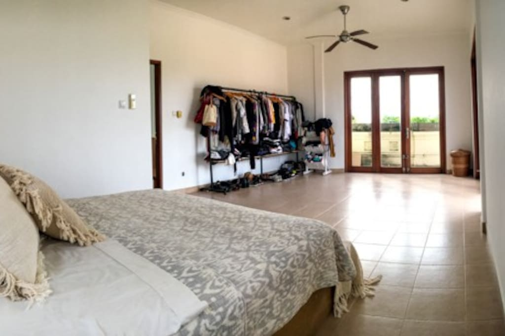 Huge 2nd level master bedroom with natural light and air-conditioning.