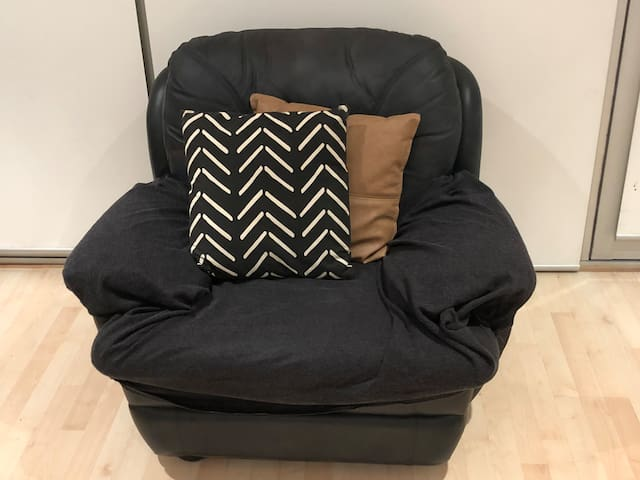 Comfy armchair for curling up with a book and a glass of red